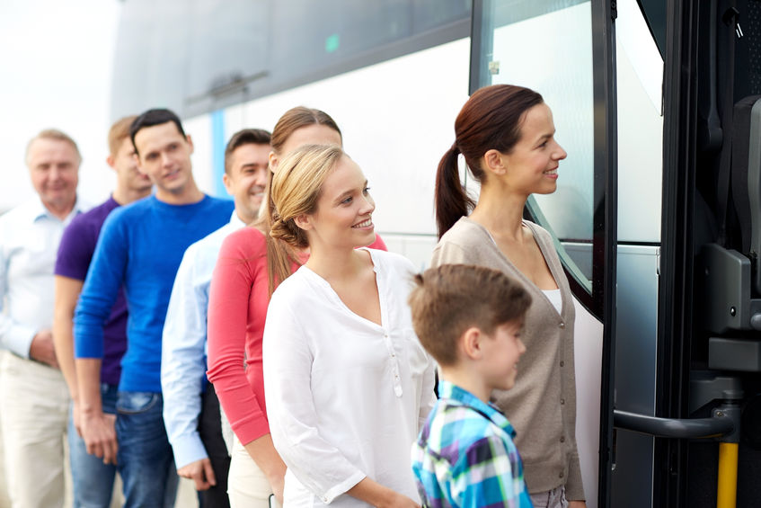 58626789 - transport, tourism, road trip and people concept - group of happy passengers boarding travel bus